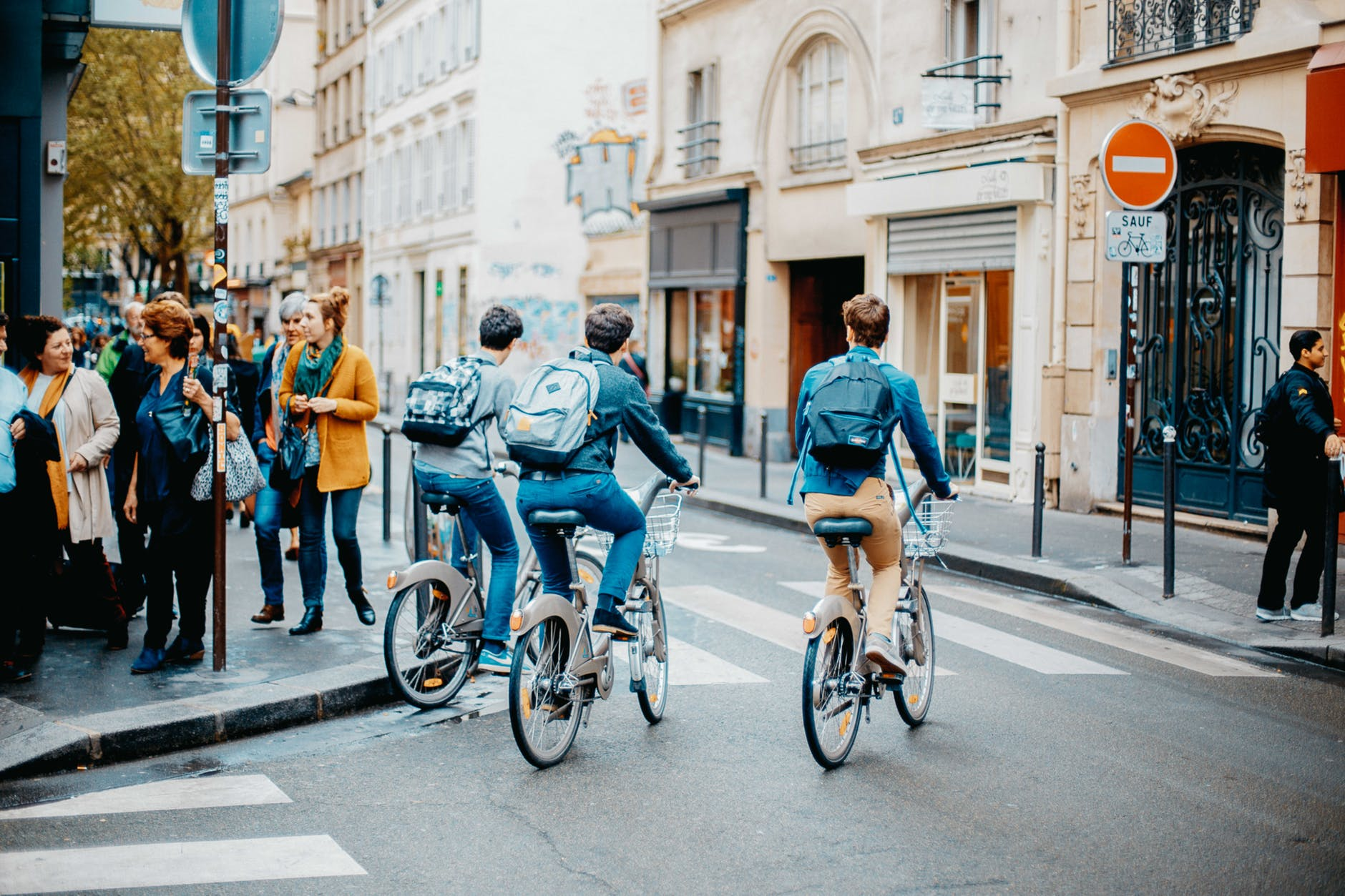 photo of people riding bicycle on street